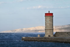 Picture represents the lighthouse while blowing strong wind. Croatia-Senj stock photography