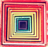 Picture of retro multicolor boxes toy that forms into geometrical square pattern Royalty Free Stock Image