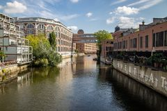 Picture from the river elster in the scene district leipzig schleussig with beautiful lofts in old industrie buildings. Picture from the river elster in the near royalty free stock images