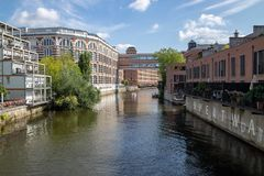 Picture from the river elster in the scene district leipzig schleussig with beautiful lofts in old industrie buildings. Picture from the river elster in the near royalty free stock photography