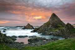 This is a picture of the rocky coast at Ballintoy on the Antrim Coast in Northern Ireland. It was taken at sunset.  royalty free stock images