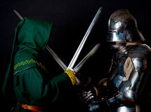 Picture of rogue and knight. Picture of two rivals. Rogue and knight Royalty Free Stock Photography