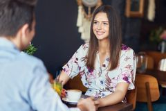 Romantic couple dating in restaurant. Picture of romantic couple dating in pub royalty free stock photos