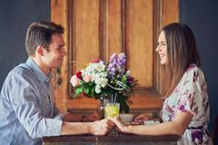 Romantic couple dating in restaurant. Picture of romantic couple dating in pub royalty free stock photography