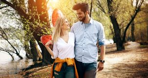 Picture of romantic couple standing outside with baloons. Picture of romantic couple outside with baloons Royalty Free Stock Image
