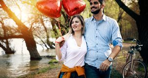 Picture of romantic couple standing outside with baloons. Picture of romantic couple outside with baloons Stock Images