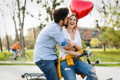 Picture of romantic couple standing outside with baloons. Picture of romantic couple outside with baloons Royalty Free Stock Photography