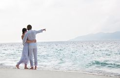 Picture of romantic young couple on the sea shore Stock Images