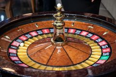 Roulette spinning, in movement, during a demo game. Roulette is a gambling and betting casino game. Picture of a roulette turning fast with a white ball on it royalty free stock image
