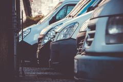 White Parked Vans. A picture of a row of white parked vans in Niort royalty free stock images