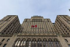Fairmont Royal York hotel in Toronto, Ontario, seen from the bottom with a Canadian flag waiving. royalty free stock photo