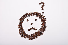 Picture of sad face with question mark made of coffee beans on Royalty Free Stock Image