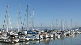 Sailing boats in San Francisco USA. A picture of sailing boats in San Francisco, USA, with hills at the horizon taken during in a sunny day at a daytrip in the Stock Photos