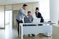 Picture of sales agents working together in office. Picture of sales agents working together in company office Royalty Free Stock Photos