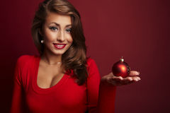 Picture of santa helper girl with ball Royalty Free Stock Photo