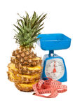 Picture of scale with pineapple Royalty Free Stock Image