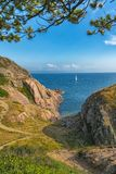 Picture of sea overview with boat on the water and house Royalty Free Stock Images