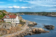 Picture of sea overview with boat on the water and house.  Stock Photos