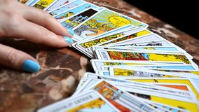 Tarot Reading Cards. In this picture we see  a person who is performing a tarot reading with a Rider-Waite deck Stock Image