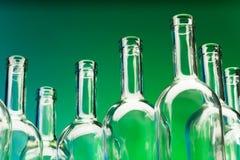 Picture of seven empty wine bottles` bottlenecks Stock Photography