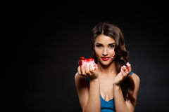 Picture of sexy woman in blue dress holding piece of cake Stock Photos