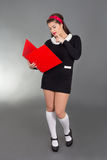 Picture of sexy woman in school form with red folder Royalty Free Stock Photography