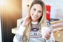 Adult woman relaxing at home during Christmas time stock photos