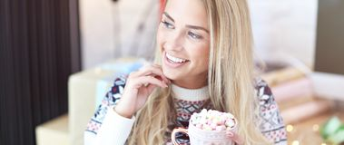 Adult woman relaxing at home during Christmas time royalty free stock photo