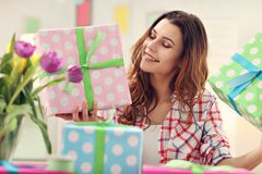 Attractive woman with Easter presents. Picture showing attractive woman preparing Easter presents at home Royalty Free Stock Images