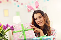 Attractive woman with Easter presents. Picture showing attractive woman preparing Easter presents at home Royalty Free Stock Photography
