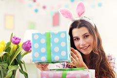 Attractive woman with Easter presents. Picture showing attractive woman preparing Easter presents at home Royalty Free Stock Photo