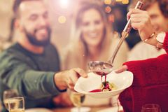 Group of family and friends celebrating Christmas dinner Stock Image