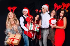 Picture showing group of friends with Christmas presents . Friends celebrating Christmas or New Year eve party royalty free stock photo