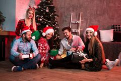 Picture showing group of friends with Christmas presents on party at home stock photo