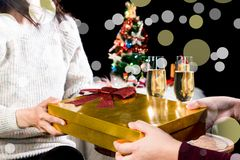 Picture showing group of friends giving and receiving christmas. Gift for friend celebrating Christmas at home and Excited To Open Box Royalty Free Stock Photo