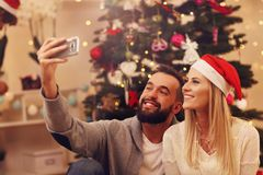 Group of friends having fun during Christmas Stock Photos