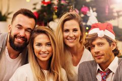 Group of friends having fun during Christmas Stock Photo