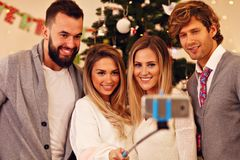 Group of friends having fun during Christmas Royalty Free Stock Image