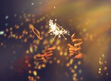 Picture showing group of hand having fun with sparklers. stock photography
