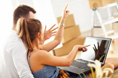 Happy adult couple moving out or in to new home Royalty Free Stock Photos