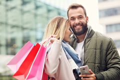 Happy couple shopping in the city Stock Images