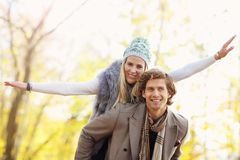 Happy couple walking in the forest during autumn. Picture showing happy couple walking in the forest during autumn Stock Images