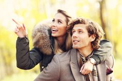 Happy couple walking in the forest during autumn. Picture showing happy couple walking in the forest during autumn Royalty Free Stock Images