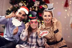 Happy family having fun during Christmas time Stock Photo