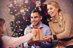 Happy family having fun with presents during Christmas time Stock Photography