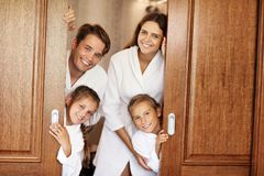 Happy family relaxing in hotel room stock images