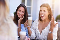 Happy girl friends in cafe during summer time Stock Photography
