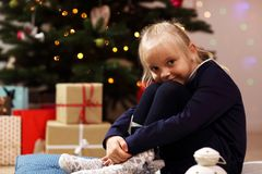 Happy girl posing with presents during Christmas time Royalty Free Stock Photography