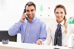 Happy team of hotel receptionists Royalty Free Stock Photography
