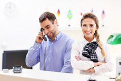 Happy team of hotel receptionists Stock Photo